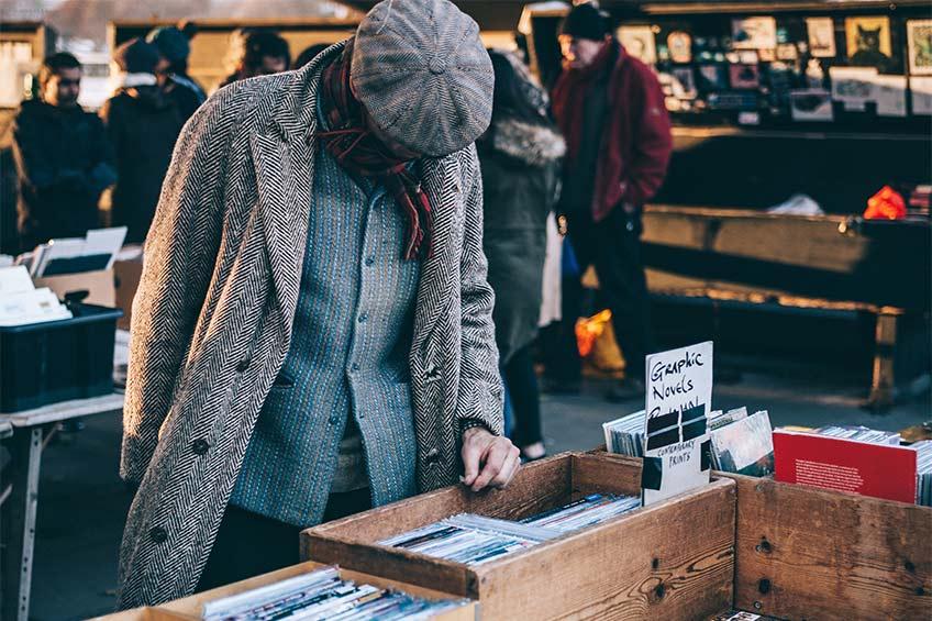 man shopping at a yard sale