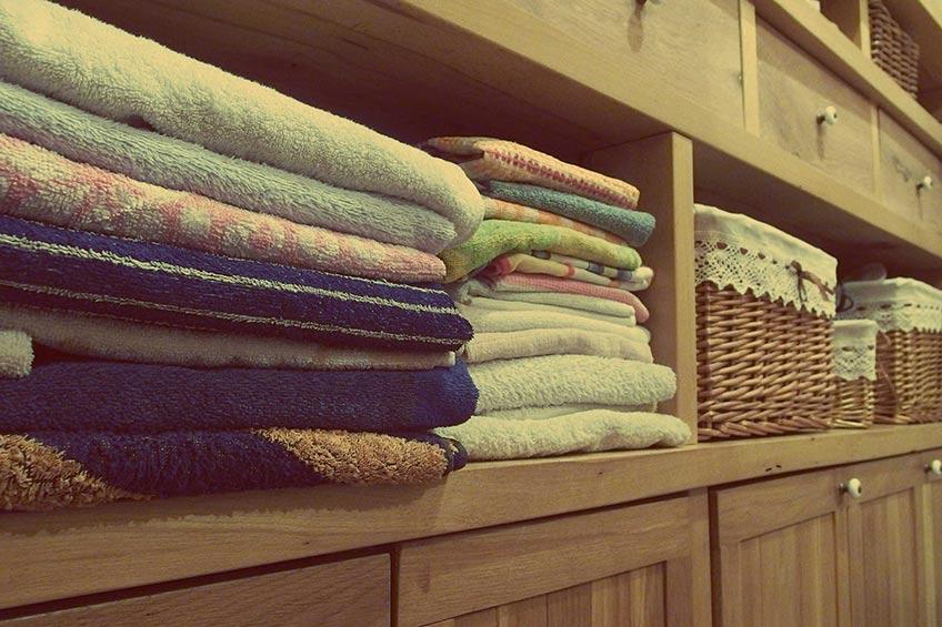 folded clothes on shelf