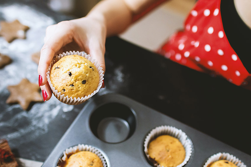person baking muffins