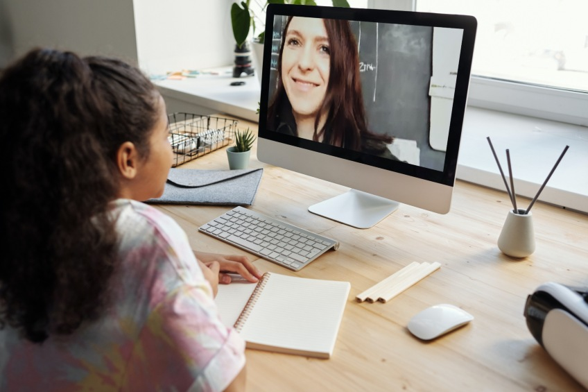 student on video chat with teacher