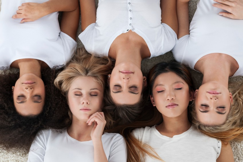 diverse group of women lying on the carpet
