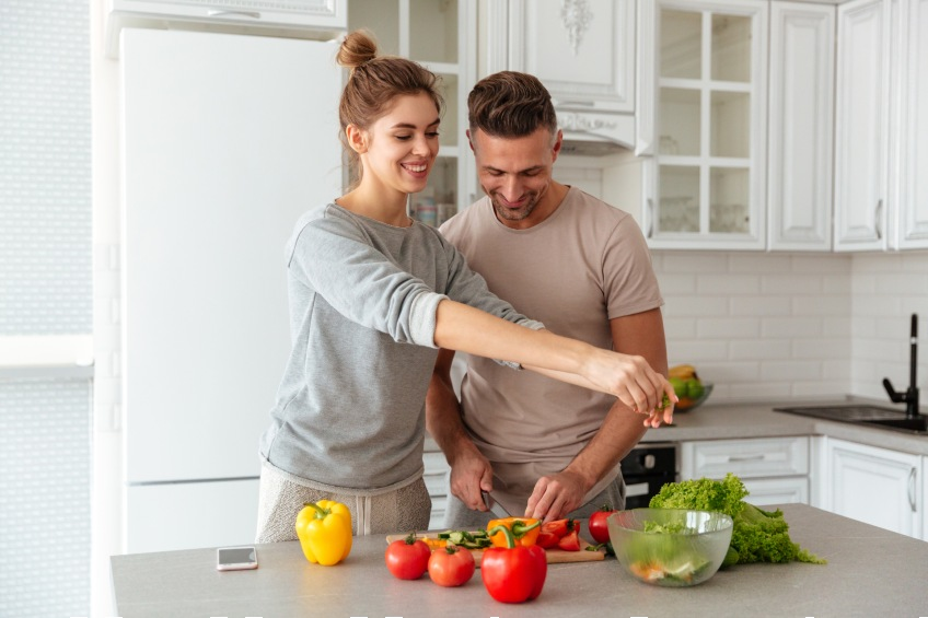 two people making healthy food