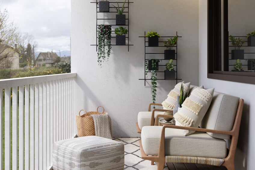 balcony with couch and plants